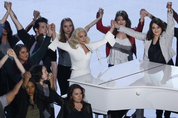 Lady Gaga holds hands with survivors of sexual abuse at the 88th Academy Awards in Hollywood